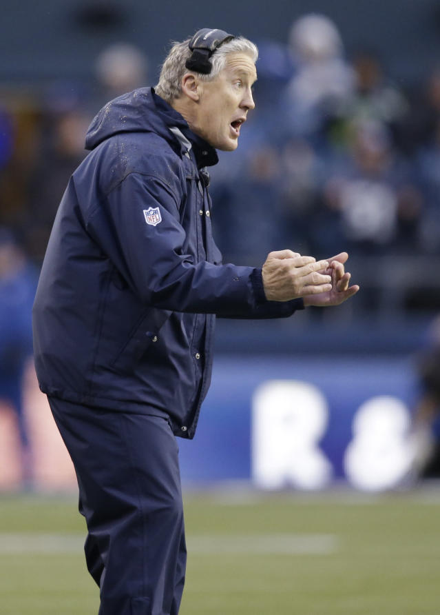Seattle Seahawks coach Pete Carroll yells on the sideline during the second half of the Seahawks' NFC divisional playoff NFL football game against the New Orleans Saints in Seattle, Saturday, Jan. 11, 2014. (AP Photo/Elaine Thompson)