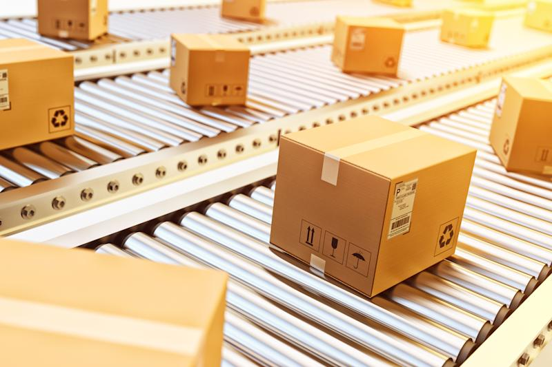 Cardboard boxes on conveyor belts.
