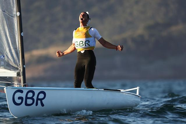 <p>Giles Scott of Great Britain reacts after sealing the gold medal in the Finn class ra on Day 9 of the Rio 2016 Olympic Games at the Marina da Gloria on August 14, 2016 in Rio de Janeiro, Brazil. (Photo by Clive Mason/Getty Images) </p>