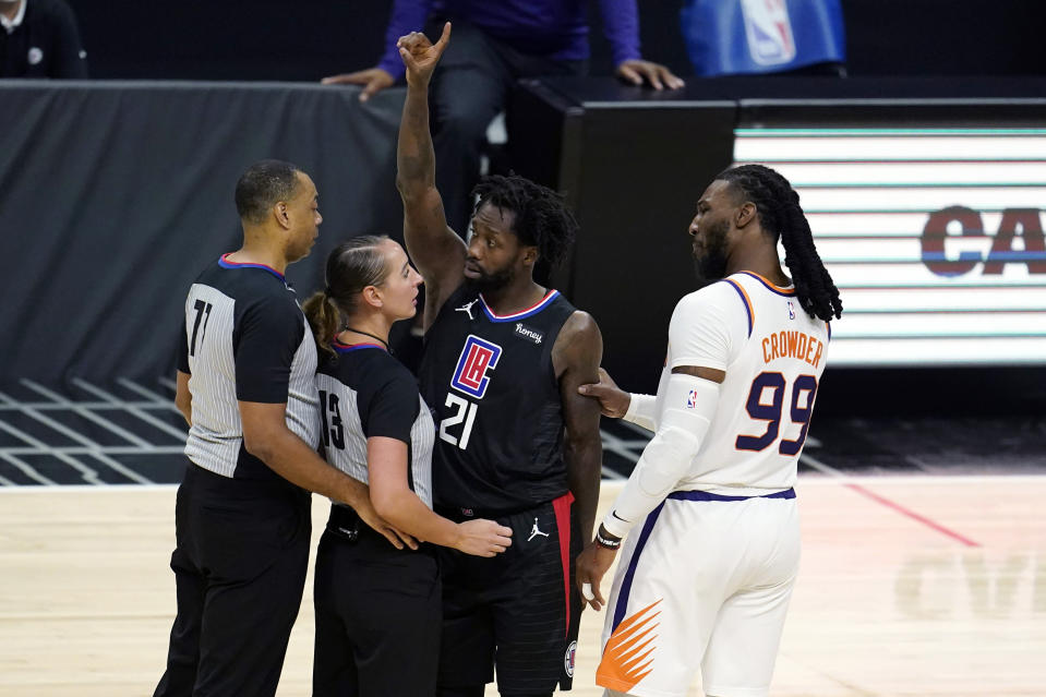 Phoenix Suns forward Jae Crowder (99) grabs Los Angeles Clippers guard Patrick Beverley (21) by the arm after Beverley fouled Suns guard Chris Paul during the second half of an NBA basketball game Thursday, April 8, 2021, in Los Angeles. Beverley was ejected for a flagrant foul. (AP Photo/Marcio Jose Sanchez)