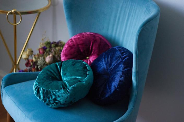 Crushed Velvet Throw Pillows atop a blue love seat