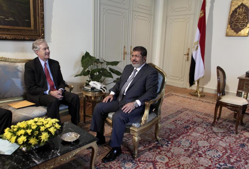 U.S. Undersecretary of State William Burns, left, meets with Egyptian President Mohammed Morsi, right, at the Presidential palace in Cairo, Egypt, Sunday, July 8, 2012. Morsi is the country's first democratically-elected president, first Islamist, and civilian to take office in Egypt. He was sworn in last week. (AP Photo/Maya Alleruzzo)