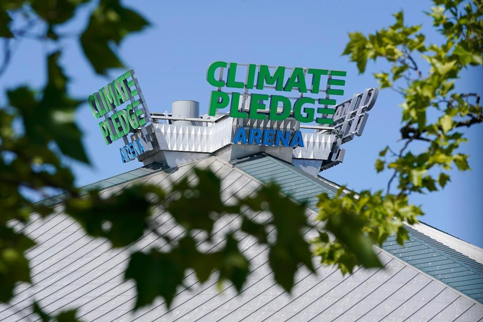 The rooftop sign for Climate Pledge Arena, home of the NHL hockey team Seattle Kraken and the WNBA Seattle Storm basketball team.