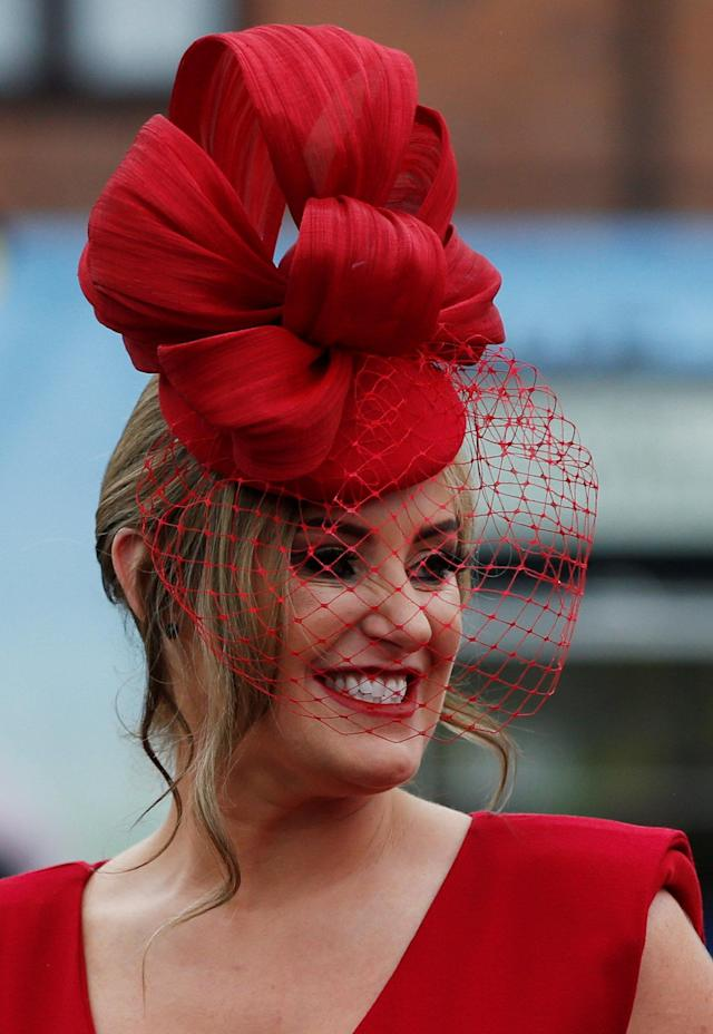 Horse Racing - Grand National Festival - Aintree Racecourse, Liverpool, Britain - April 13, 2018 Racegoer during Ladies Day at the Grand National Festival REUTERS/Andrew Yates