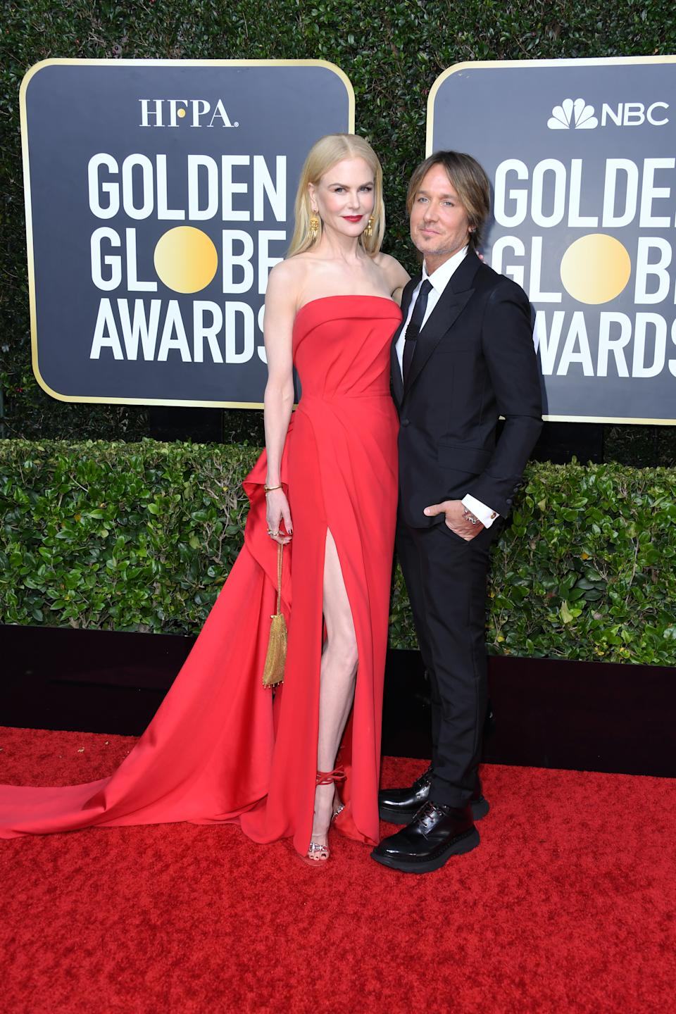 """The """"Big Little Lies"""" and """"Bombshell"""" actress looked stunning in a red gown by Atelier Versace. (Photo by Jon Kopaloff/Getty Images)"""
