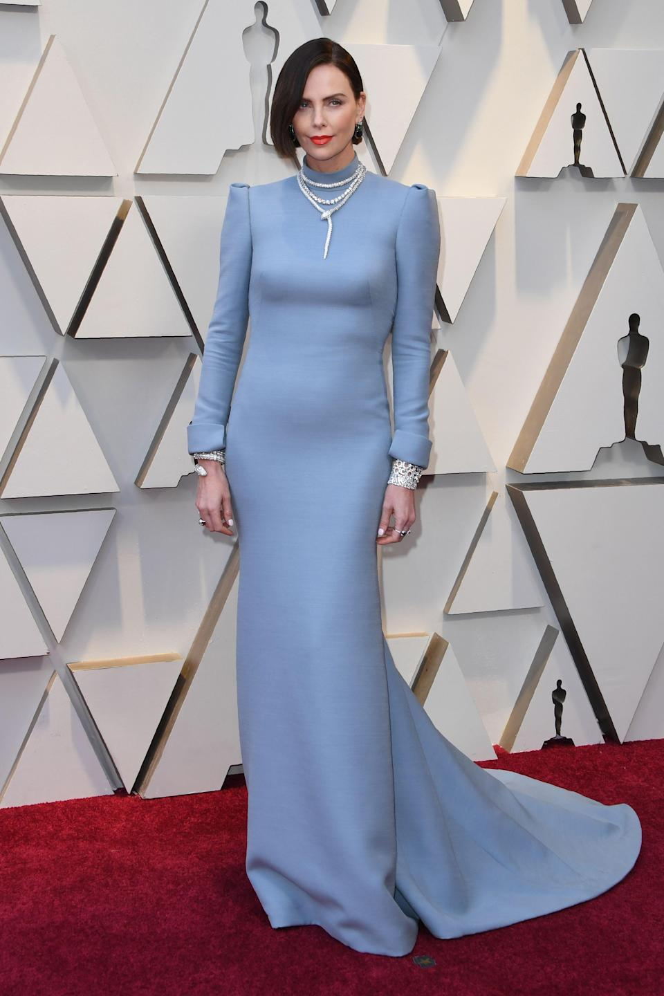 <p>Theron ooked almost unrecognizable as she arrived on the red carpet debuting a dark new hair style in custom Dior. (Image via Getty Images) </p>