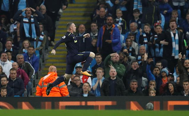 Wayne Rooney celebrates in front of the Etihad crowd. (Reuters)