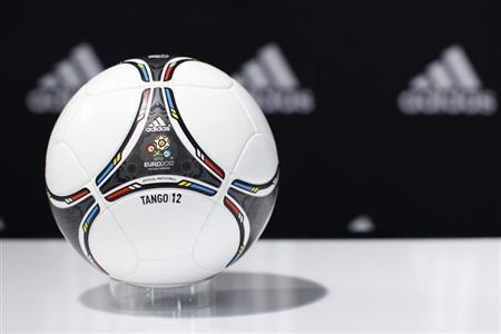 """A """"Tango 12"""" soccer ball for the upcoming Euro 2012 soccer tournament is displayed during a news conference at the sporting goods maker Adidas shop in Paris"""