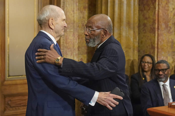 The Rev. Amos C. Brown, right, and President Russell M. Nelson of The Church of Jesus Christ of Latter-day Saints hug during a news conference Monday, June 14, 2021, in Salt Lake City. Top leaders from the NAACP and The Church of Jesus Christ of Latter-day Saints announced $9.25 million in new educational and humanitarian projects as they seek to build on an alliance formed in 2018. (AP Photo/Rick Bowmer)