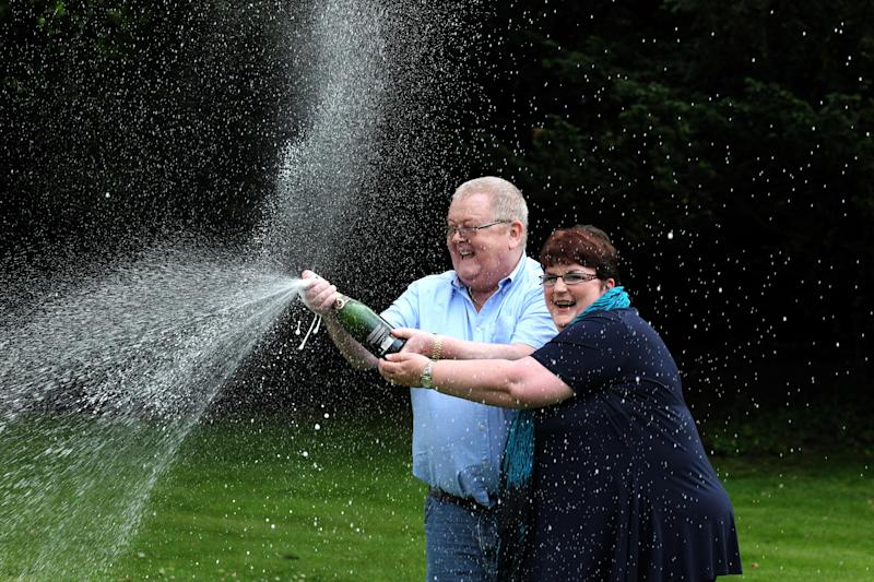 Colin and Chris Weir, from Largs in Ayrshire, celebrate during a photo call at the Macdonald Inchyra Hotel & Spa in Falkirk, after they scooped 161 million in Tuesday's EuroMillions draw. (Photo by Andrew Milligan/PA Images via Getty Images)