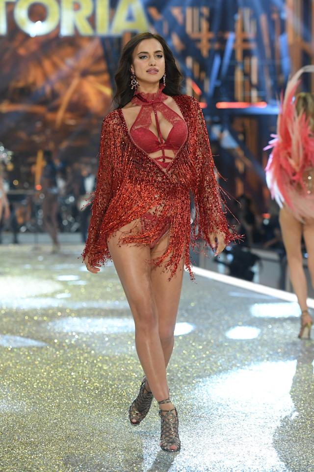 <p>Doesn't this red ensemble as seen on Irina Shayk look like an outfit Jennifer Lopez would wear? <em>(Photo: Getty Images)</em> </p>