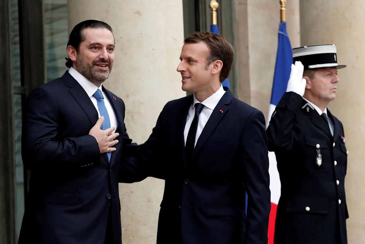French President Emmanuel Macron and Saad al-Hariri, who announced his resignation as Lebanon's prime minister while on a visit to Saudi Arabia, react on the steps of the Elysee Palace in Paris, France, November 18, 2017. REUTERS/Benoit Tessier     TPX IMAGES OF THE DAY