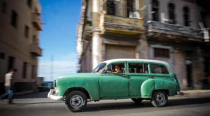 An old American car is seen on a street in Havana, Cuba, on December 19, 2014 (AFP Photo/Yamil Lage)