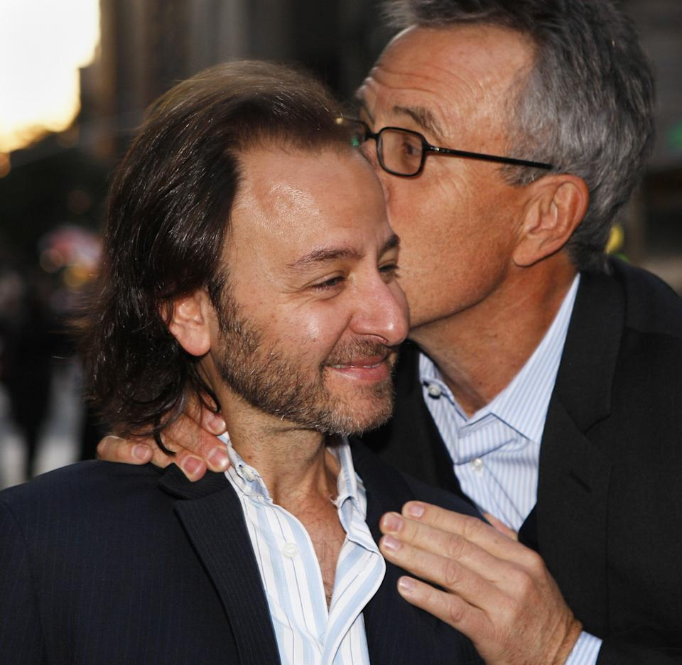 US actor Fisher Stevens (L) is greeted by a friend as he arrives for a screening of