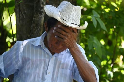 Santos Perez Ortiz, 75, reacts as a forensic team exumes human remains, said to belong to his relatives killed in the 1981 El Mozote massacre