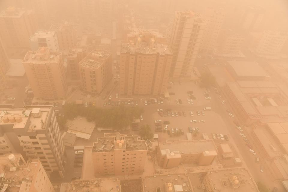 A sandstorm engulfs the city centre, in Kuwait City last week (Anadolu Agency via Getty Images)