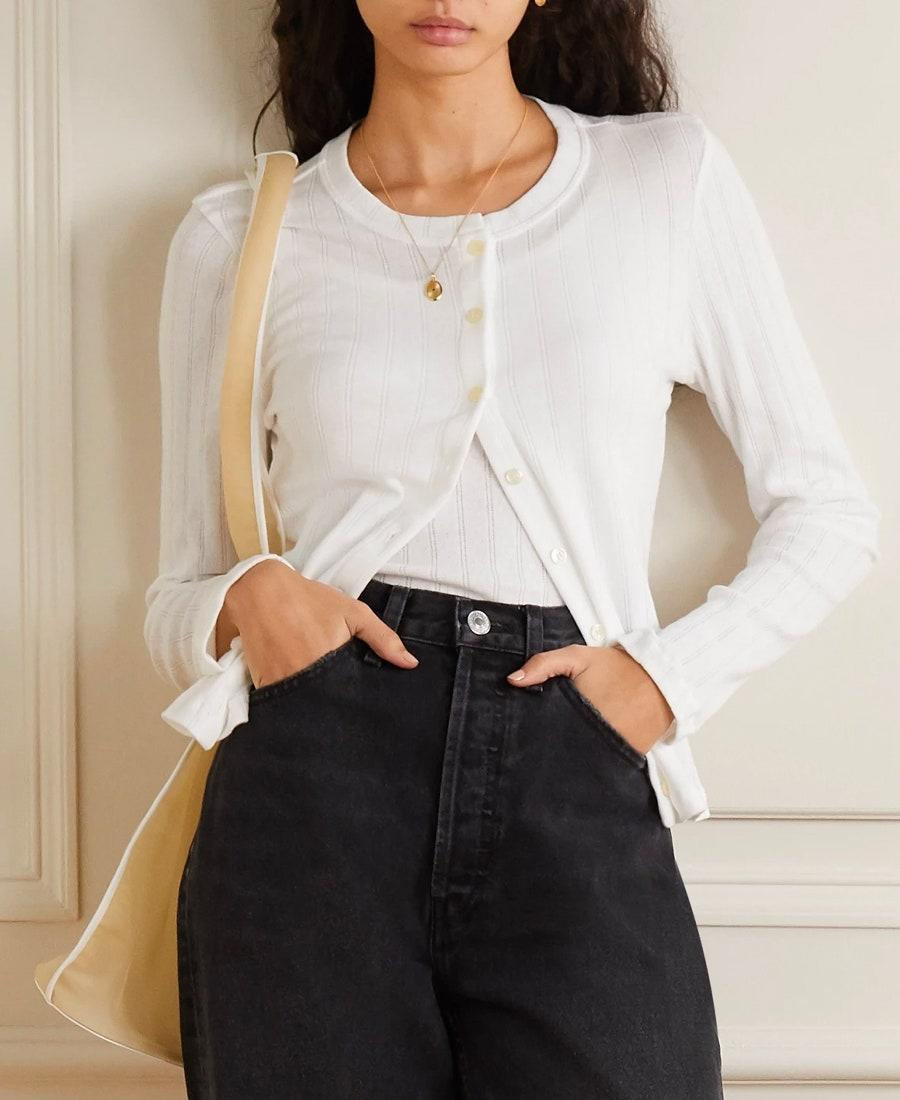 """Leset is an under-the-radar brand that makes seriously cute basics sets, like this pointelle-knit cardigan and <a href=""""https://click.linksynergy.com/deeplink?id=3r4YdkDiq/o&mid=24449&u1=bestfallsweaters&murl=https%3A%2F%2Fwww.net-a-porter.com%2Fen-us%2Fshop%2Fproduct%2Fleset%2Fpointelle-knit-cotton-jersey-tank%2F1232568"""" rel=""""nofollow noopener"""" target=""""_blank"""" data-ylk=""""slk:coordinating tank"""" class=""""link rapid-noclick-resp"""">coordinating tank</a>. $120, Net-a-Porter. <a href=""""https://www.net-a-porter.com/en-us/shop/product/leset/pointelle-knit-cotton-jersey-cardigan/1232567"""" rel=""""nofollow noopener"""" target=""""_blank"""" data-ylk=""""slk:Get it now!"""" class=""""link rapid-noclick-resp"""">Get it now!</a>"""