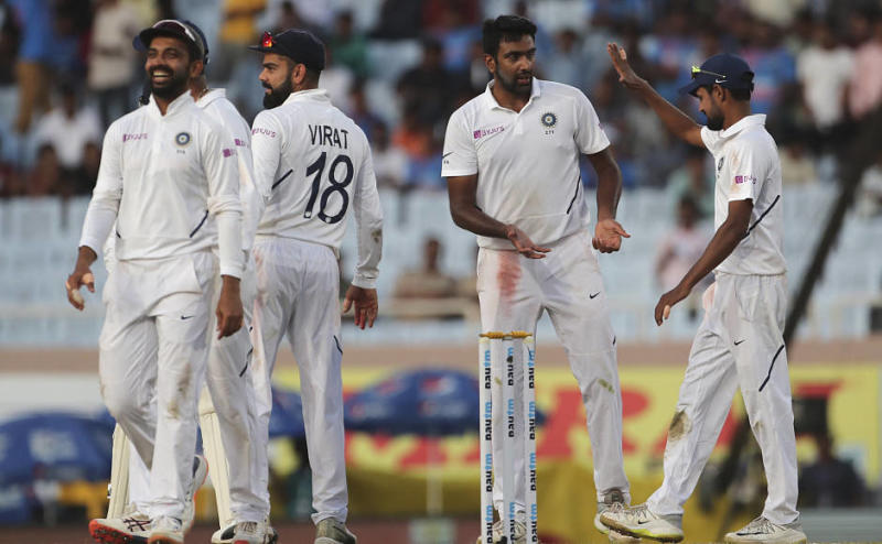 Ravichandran Ashwin and his India teammates celebrate the dismissal of Kagiso Rabada, who was the last to depart on another day dominated by the hosts. AP