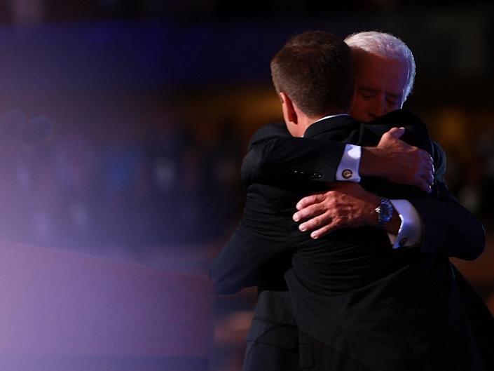 <p>Joe Biden hugs his late son Beau Biden, during day three of the Democratic National Convention (DNC) at the Pepsi Centre 27 August 2008 in Denver, Colorado</p> ((Getty Images))