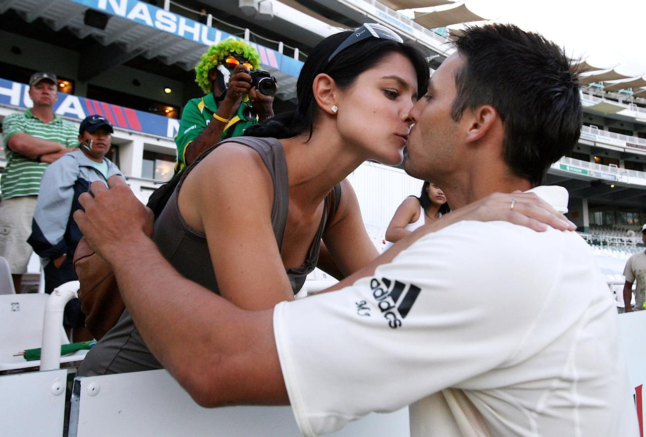 CAPE TOWN, SOUTH AFRICA - MARCH 22:  Mitch Johnson of Australia is congratulated by girlfriend Jessica Bratich after his maiden Test century during day four of the Third Test between South Africa and Australia played at Newlands on March 22, 2009 in Cape Town, South Africa.  (Photo by Hamish Blair/Getty Images)