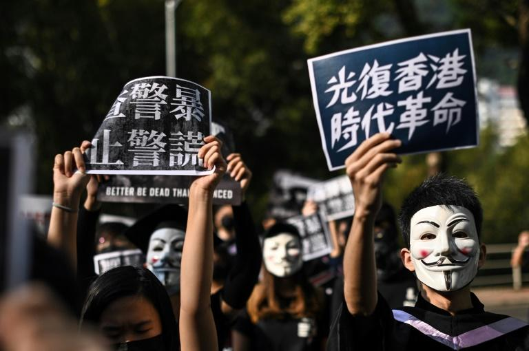 Since the first mass demonstrations in June, more than 3,300 people have been arrested in Hong Kong in connection to the protestmovement, with some charged for rioting and illegal assembly (AFP Photo/Philip FONG)
