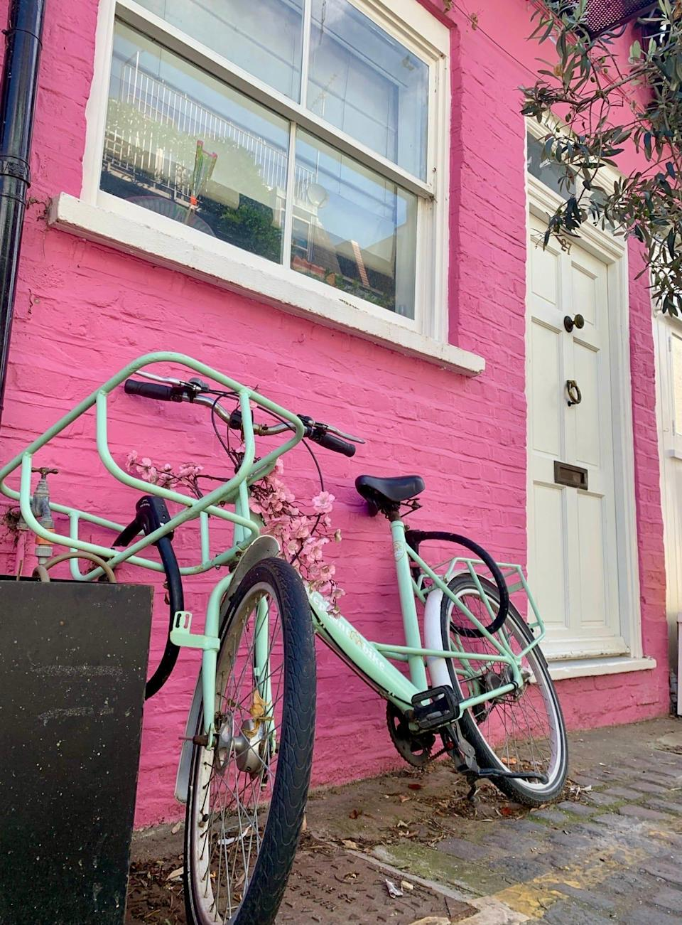 A green bicycle sits out front number 27, St. Lukes Mews.