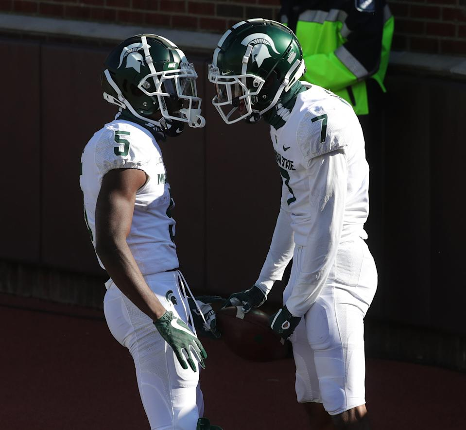 Michigan State Spartans receivers Jayden Reed (5) and Ricky White (7) celebrate after White's touchdown against the Michigan Wolverines during the first quarter at Michigan Stadium in Ann Arbor, Saturday, Oct. 31, 2020.