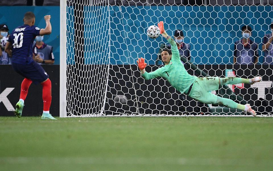 Switzerland's goalkeeper Yann Sommer (R) saves a penalty by France's forward Kylian Mbappe during the UEFA EURO 2020 round of 16 football match between France and Switzerland at the National Arena in Bucharest - GETTY IMAGES