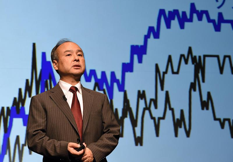 Softbank president Masayoshi Son speaks during a press conference announcing the company's financial results, in Tokyo, on August 8, 2014 (AFP Photo/Toshifumi Kitamura)