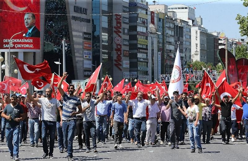 People wave national flags as they march from Kizilay square to Turkish General Staff building to react against military coup attempt, in Ankara, on July 16, 2016, following an attempt by discontented soldiers to seize power fromthe government (AFP Photo/Adem Altan)