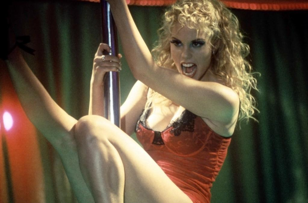 """<a href=""""http://movies.yahoo.com/movie/1800024516/info"""">SHOWGIRLS</a> (1995)   """"Showgirls"""" was advertised as a racy erotic thriller, proudly wearing its """"NC-17"""" rating on its bedazzled sleeve. But instead of """"<a href=""""http://movies.yahoo.com/movie/1800173852/info"""">Basic Instinct</a>"""" -- director Paul Verhoeven and screenwriter Joe Eszterhas's previous collaboration -- audiences got something much weirder and sleazier. What do you make of a scene where the two main characters bond over their shared childhood love of dog food? Or that bizarre swimming pool love scene with Kyle MacLachlan? """"Showgirls"""" is filled unhinged moments like these. And they didn't happen on accident. Though star Elizabeth Berkeley delivers a go-for-broke, completely exposed --- in all senses of the term -- performance, you can almost hear Paul Verhoeven snickering in the background."""