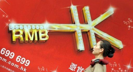 An advert promoting yuan is seen here outside a bank in Hong Kong, in 2011. China's central bank said it would widen the yuan's trading band against the dollar, loosening currency controls in a major step towards adopting more market-oriented reforms
