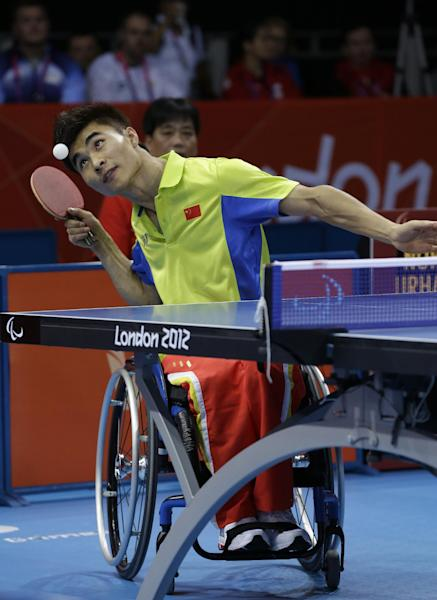 China's Ningning Cao serves the ball during the men's singles class 5 table tennis final match against Norway's Tommy Urhaug, at the 2012 Paralympics in London, Sunday, Sept. 2, 2012. Urhaug won the match and the gold medal and Cao won the silver. (AP Photo/Lefteris Pitarakis)