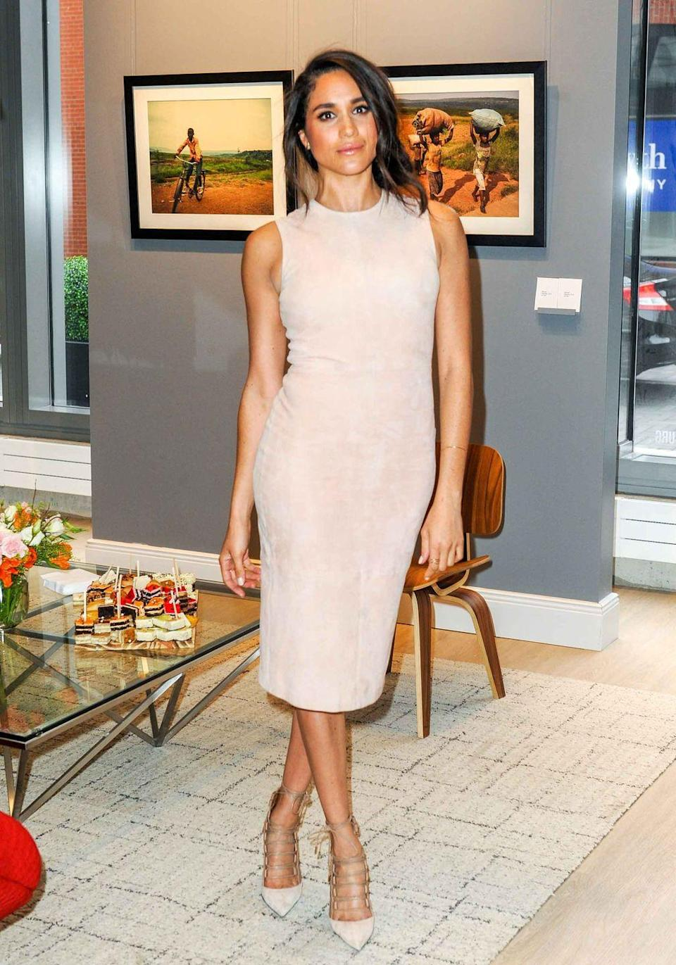 <p>Markle goes for a monochromatic nude ensemble at the World Vision event in Toronto, Canada.</p>