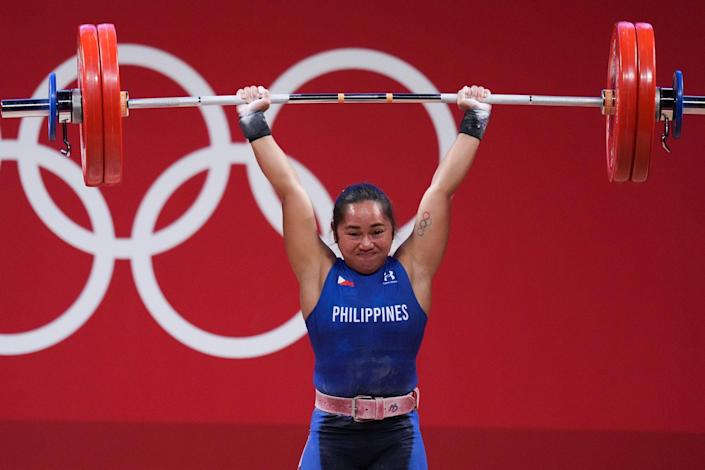 """<p>Filipina weightlifter <a href=""""https://people.com/sports/tokyo-olympic-philippines-womens-weight-lifter-gold-medal/"""" rel=""""nofollow noopener"""" target=""""_blank"""" data-ylk=""""slk:Hidilyn Diaz"""" class=""""link rapid-noclick-resp"""">Hidilyn Diaz</a> scored the first-ever gold medal for her country July 26, lifting a whopping 127kg (279 pounds!) with ease.</p>"""