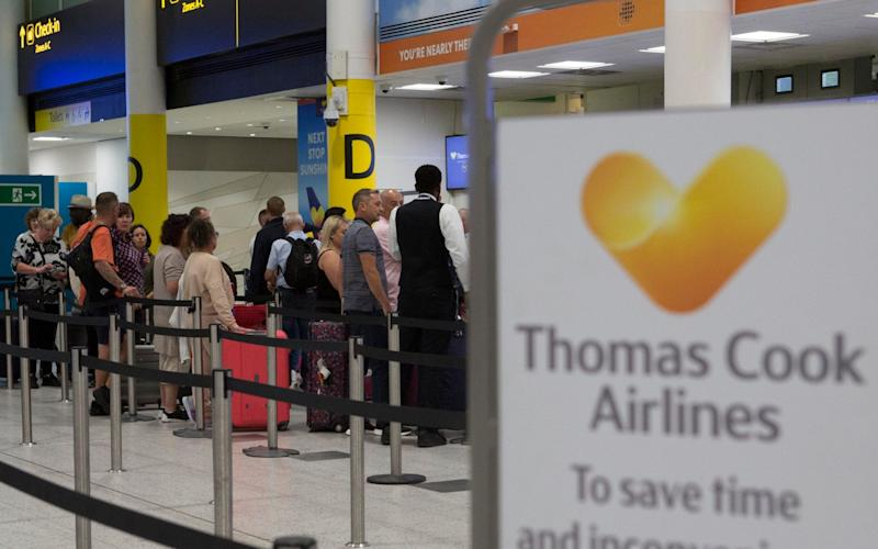 A general view of the Thomas Cook check-in desks in the South Terminal of Gatwick Airport - PA