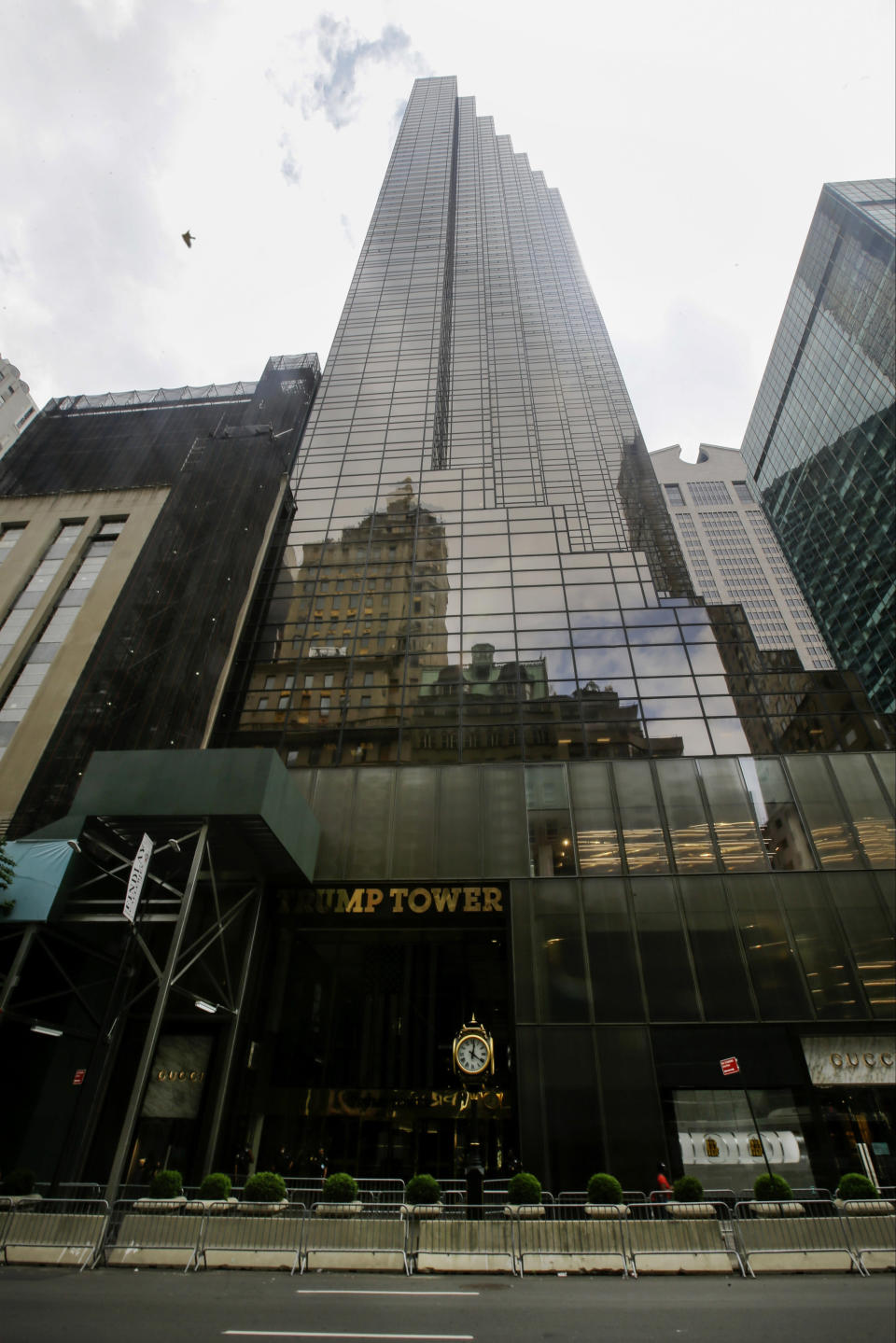 FILE - In this Tuesday, July 7, 2020 file photo, pedestrians walk past the Trump Tower building in New York. Trump's true financial picture has gotten renewed scrutiny in the wake of a New York Times report in September 2020 that he declared hundreds of millions in losses in recent years, allowing him to pay just $750 in taxes the year he won the presidency, and nothing for 10 of 15 years before that. (AP Photo/Frank Franklin II, File)
