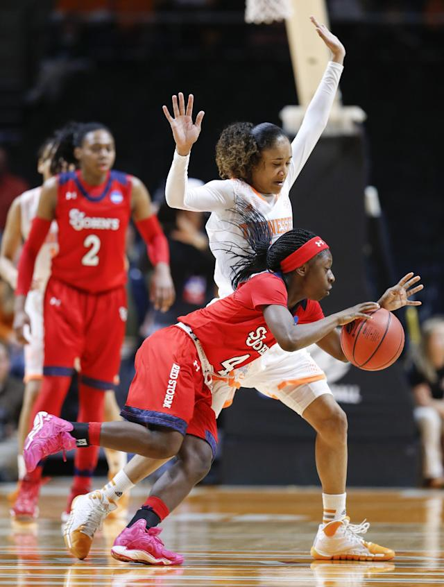 St. John's guard Aaliyah Lewis (4) drives against Tennessee guard Meighan Simmons, top, in the first half of an NCAA women's college basketball second-round tournament game Monday, March 24, 2014, in Knoxville, Tenn. (AP Photo/John Bazemore)