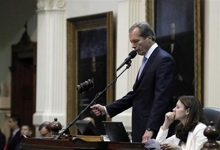 Texas Lieutenant Governor Dewhurst strikes the gavel after the Senate passed legislation restricting abortion rights in Austin