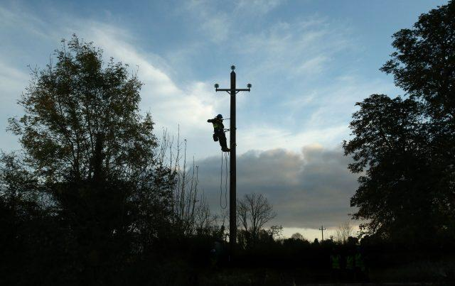 Workers in Kilcock, Ireland, clear fallen power lines after Ophelia batterred the country with gusts of up to 80mph (Niall Carson/PA)