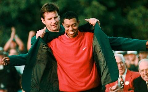 <span>Masters champion Tiger Woods receives his Green Jacket from Nick Faldo in 1997</span> <span>Credit: AP </span>