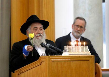 Rabbi Yisroel Goldstein holds a yellow rose given to his family by Lori Gilbert-Kaye, days before she shielded the rabbi and became the sole fatality of Saturday's shooting at Congregation Chabad synagogue in Poway, north of San Diego, California, U.S. April 29, 2019.  REUTERS/John Gastaldo