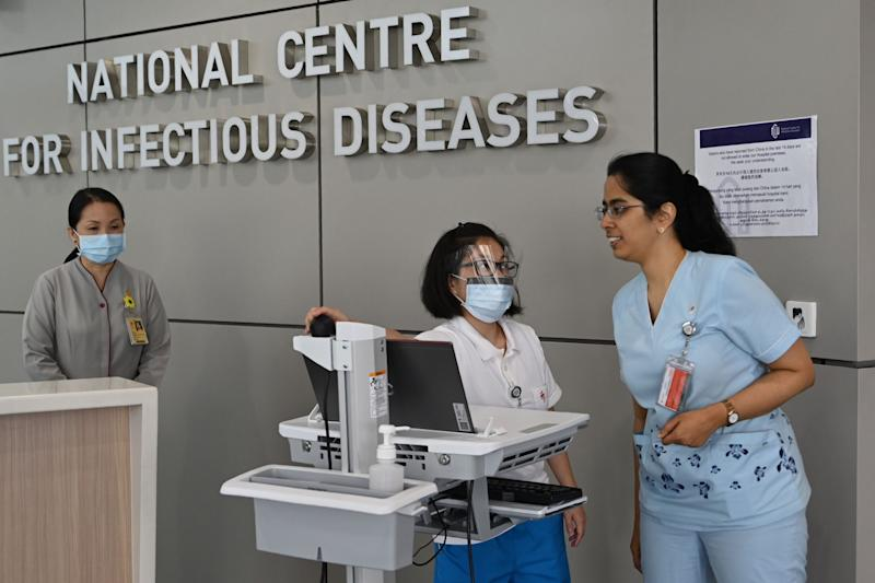 Medical staff prepare pre-screening procedure at the National Centre for Infectious Diseases building at Tan Tock Seng Hospital in Singapore on 31 January, 2020. (PHOTO: AFP via Getty Images)