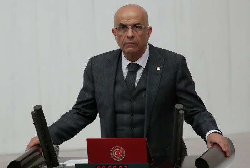FILE PHOTO: Enis Berberoglu, the first lawmaker from the main opposition Republican People's Party jailed amid government purges following a failed military coup in 2016 and released from prison last month takes his oath at the Turkish parliament in Ankara