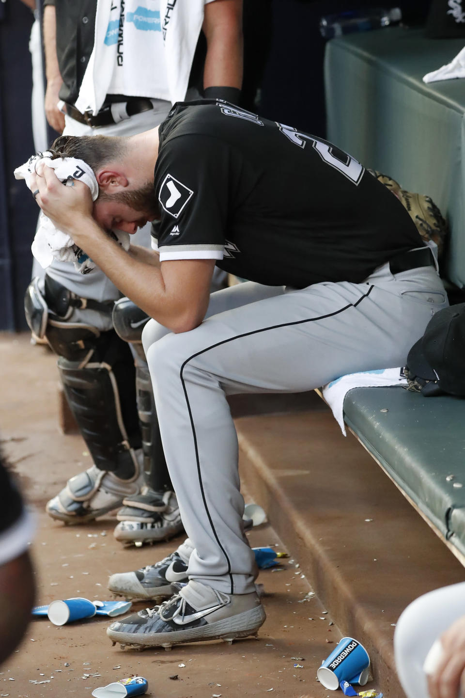 Chicago White Sox starting pitcher Lucas Giolito sits on the bench after giving up a two-run home run to Atlanta Braves' Freddie Freeman in the sixth inning of a baseball game Sunday, Sept. 1, 2019, in Atlanta. (AP Photo/John Bazemore)