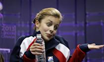 Ashley Wagner, of the United States, reacts as she watches her scores during the free skate program in the ladies competition at the World Figure Skating Championships Saturday, March 16, 2013, in London, Ontario. (AP Photo/Darron Cummings)