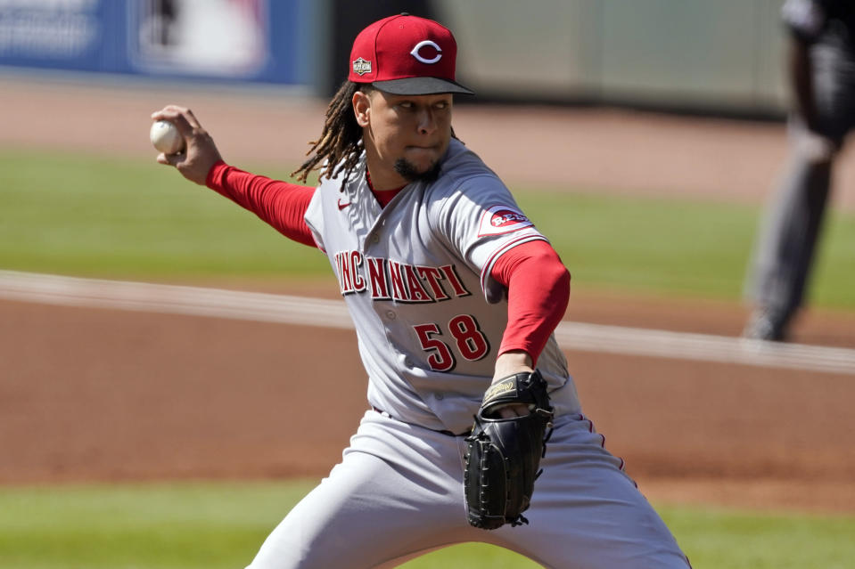 Cincinnati Reds starting pitcher Luis Castillo throws during the first inning in Game 2 of a National League wild-card baseball series, Thursday, Oct. 1, 2020, in Atlanta. (AP Photo/John Bazemore)