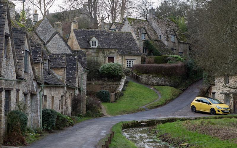 The banana-coloured Vauxhall Corsa has been the cause of controversy for spoiling the view in Bibury, Gloucestershire - Credit: SWNS