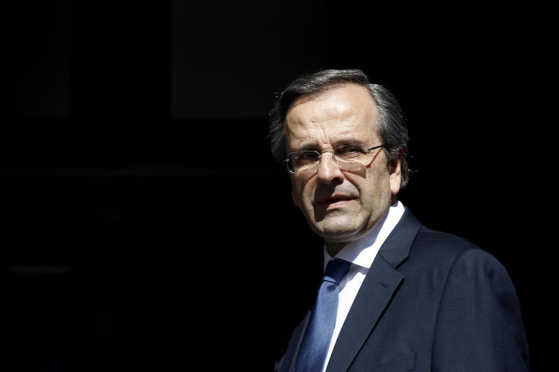 FILE - In this Wednesday, June 20, 2012 file photo shows Greece's newly sworn-in Prime Minister Antonis Samaras looks on after his meeting with outgoing caretaker Prime Minister Panayiotis Pikramenos at Maximos Mansion. Greece's new prime minister was released from hospital on Monday, June 25, 2012 two days after undergoing eye surgery that will prevent him from traveling to a European Union summit in Brussels this week. (AP Photo/Kostas Tsironis, file)