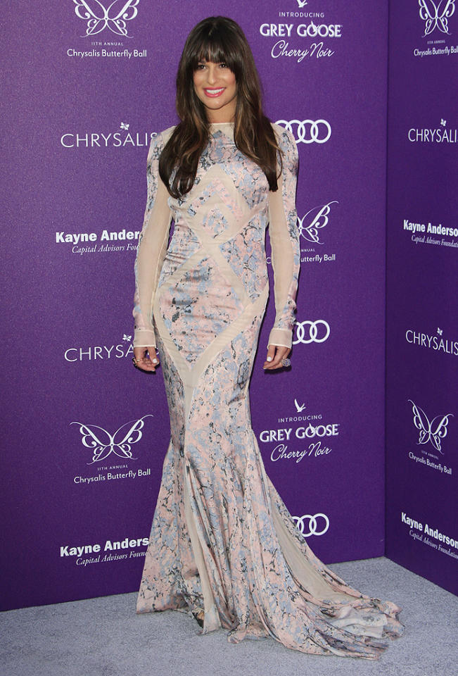 "Following in Sigler's footsteps was Lea Michele, who took a major fashion risk by opting to wear this long-sleeved, pastel Emilio Pucci gown. Some of you may find the ""Glee"" cutie's dress a tad curtain-esque, but we happen to love the watercolor print and geometric patterning, not to mention Ms. Michele's Pomellato cocktail ring. (6/9/2012)"